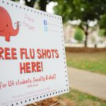 sign offering free flu shots