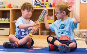Two RISE students playing in class