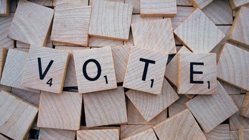 scrabble tiles spelling VOTE