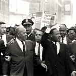 Black and white photo of crowd with Martin Luther King Jr