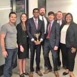 From left to right: Marco Nelson of RentCheck, Jessica Hastings, Sudarsan Murali, Dalton Kerby, Landon Robertson, Spencer Adams, and Laci Williams celebrate their first place victory.