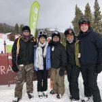 Case team standing on the ski slopes.