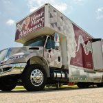 A truck that adapts into a mobile hearing clinic parked.