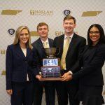 The Manderson MBA SEC Case Competition team triumphant with the trophy. L-R: Everette Dawkins, Sam Greene, John Clary, Bryonna Rivera Burrows