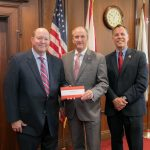 Mark Crews, of Alabama Power, makes a presentation to UA President Stuart R. Bell and Dr. Russell Mumper.