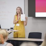 An education researcher speaks to teachers at a conference