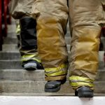 A close up of firefighters' boots descending stairs.