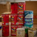 A stack of canned food symbolizes Beat Auburn Beat Hunger.
