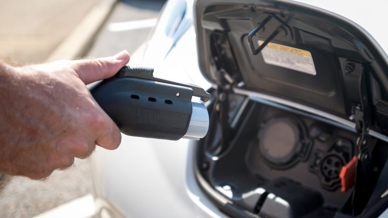 Electric car being charged on campus