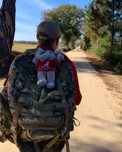 A student marches to Tuscaloosa in the first Operation Iron Ruck.