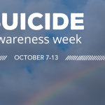 Suicide Awareness Week sign in front of a rainbow and Denny Chimes