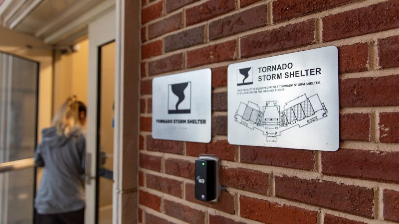 Tornado Shelter sign on the outside of North Lawn Hall