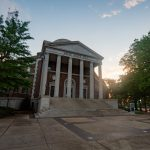 The sun sets over Reese Phifer Hall.