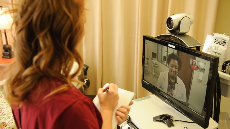 Woman receiving Telehealth services
