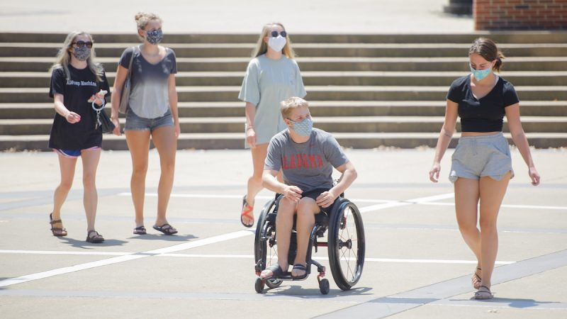 Five students with masks.