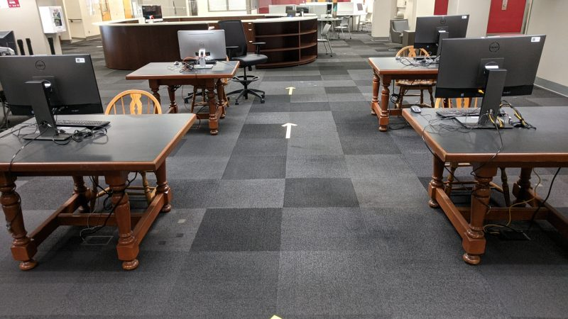Arrows point out the direction that foot traffic in the libraries should follow