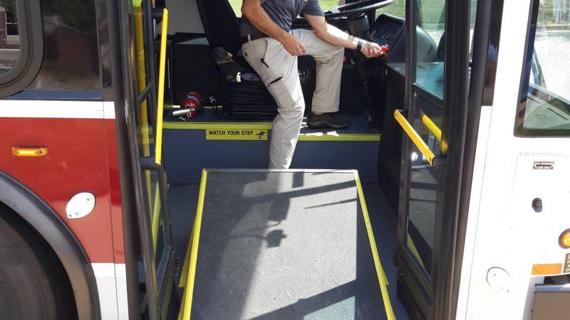 Steve Tsapatoris, transit manager, letting down the Crimson Ride handicap accessible ramp