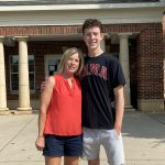 A mom and her freshman son in front of Riverside East.