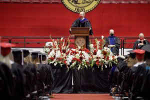 Dr. Bell speaks to students on stage at summer 2020 commencement.