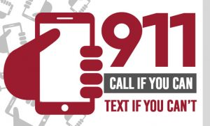 A graphic showing a hand holding a cell phone with the words 911, call if you can, text if you can't.