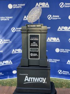 The AFCA National Championship Trophy, a crystal football on a stand