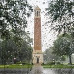 Denny Chimes through rain on a window
