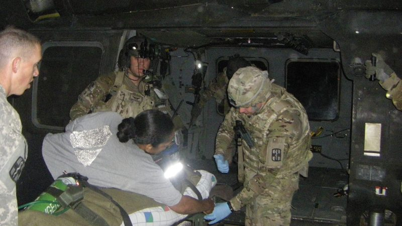Jacob Caruso transporting a patient on a helicopter in Afghanistan