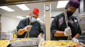 "Bama Dining staff preparing Thanksgiving meals for ""Swipe Away Hunger."""