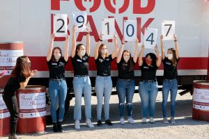 Beat Auburn Beat Hunger student organizers reveal the results of the food drive.
