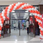 an arch of red and white balloons outside the entrance to the new Intercultural diversity center in the ferguson student center