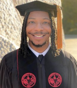 Lee Johnson wearing his graduation cap and gown.