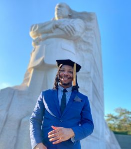 Lee Johnson standing in front of the Martin Luther King Jr. Memorial in Washington D.C.
