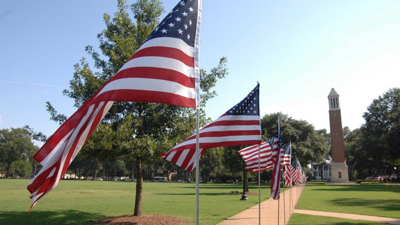 American flags wave on the UA quad.