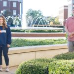 Mary Virginia McKinley stands with Dr. Gray six feet apart beside the fountains