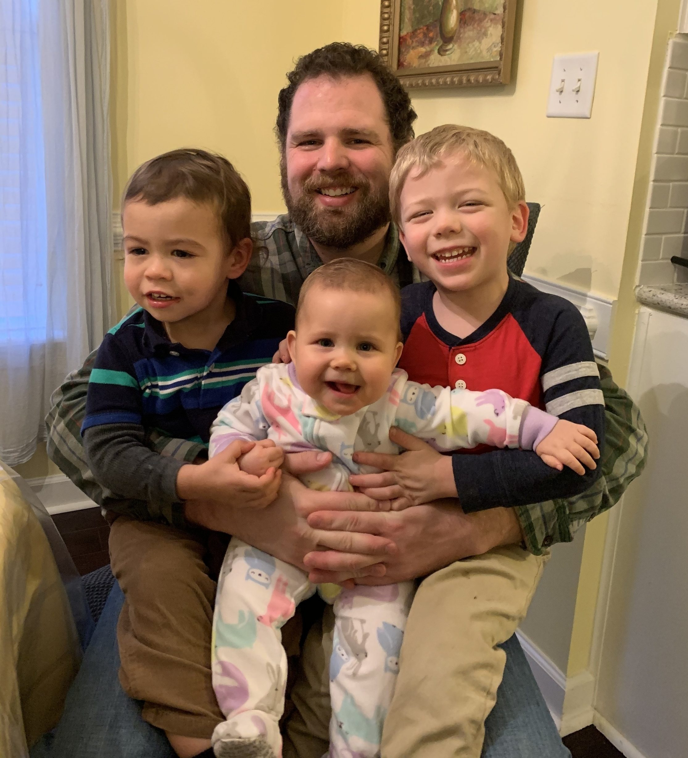 Jacob Caruso with his three children.