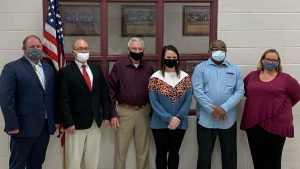 West Blocton, Alabama's mayor and five city council members pose for a photo.
