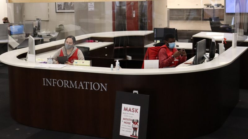 Student workers at Gorgas Library information desk.
