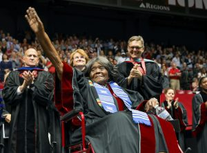 Autherine Lucy foster waves to a standing ovation crowd after receiving an honorary doctorate from UA.