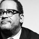 close up black and white photo of Michael Eric Dyson