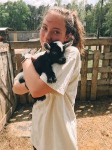 UA student holds a baby goat.