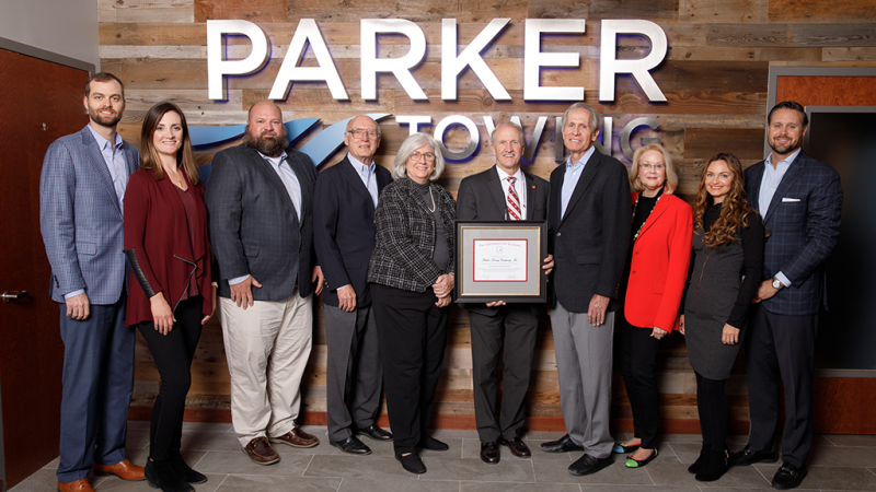 A photo of UA President Dr. Stuart Bell and members of the Parker and Haun families.