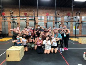 UA students pose for a picture in a CrossFit studio.