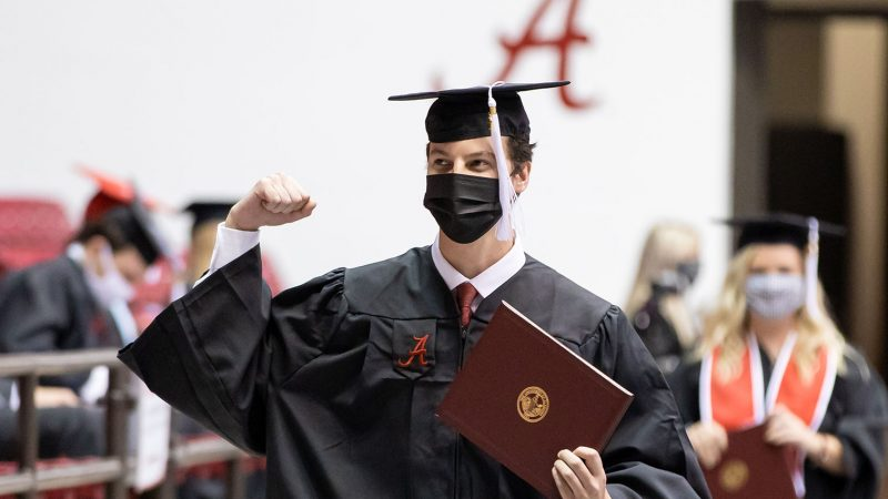 male graduate in cap and gown