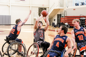 Wheelchair basketball players playing in a game.