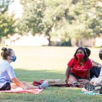 Students set on blankets on the Quad.