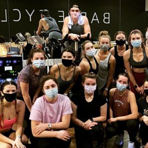 a group of women wearing masks after a barre cycle class