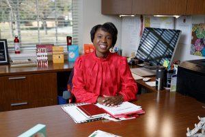 Dr. Victoria Whitfield sets at her desk.