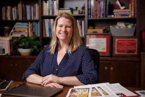 Professor Sarah Barry sits at her desk.