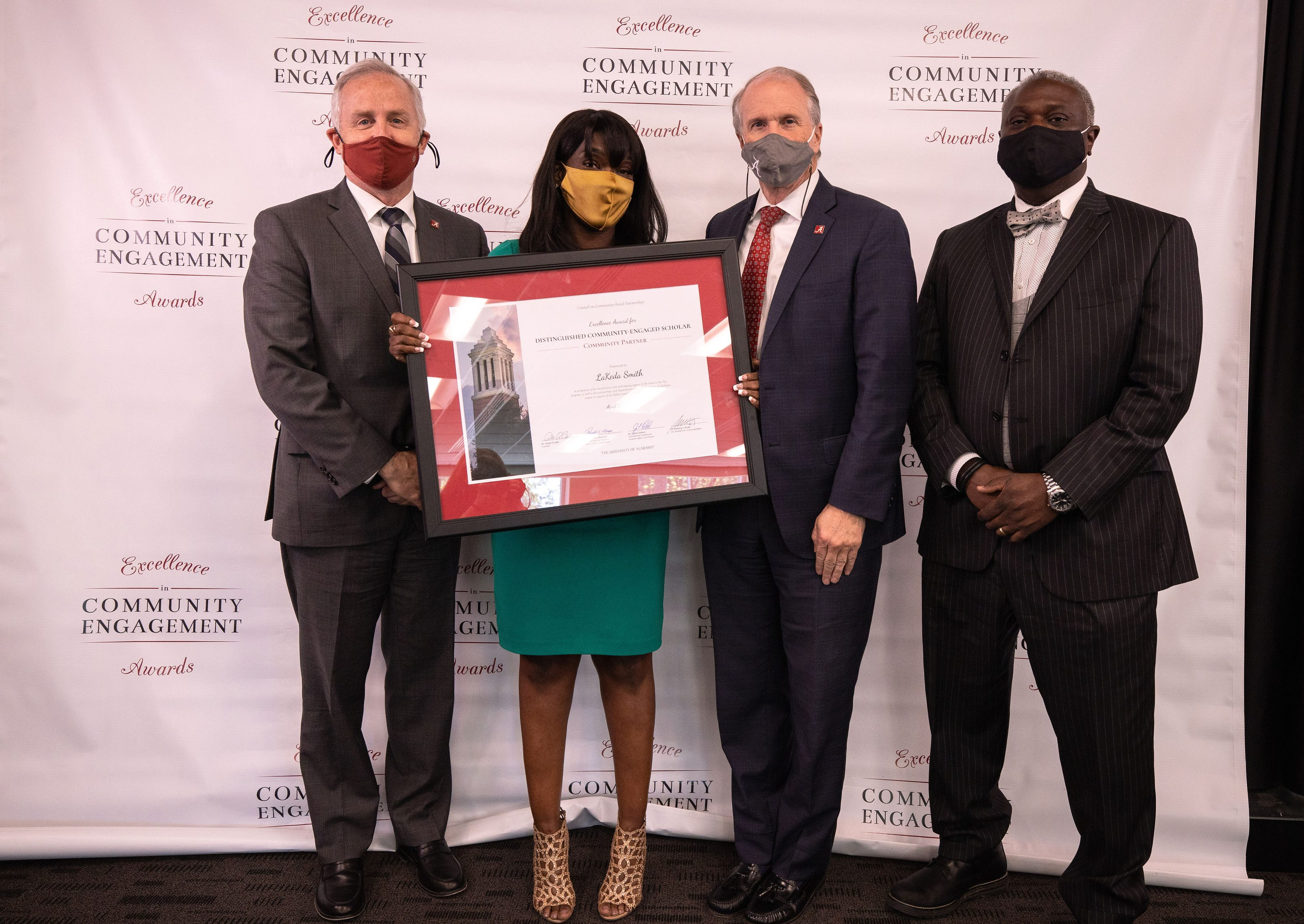 Dr. James Dalton, executive vice president and provost (far left); LaKeda Smith, executive director of the Benjamin Barnes YMCA in Tuscaloosa; President Stuart Bell; Dr. Samory Pruitt, vice president of community affairs