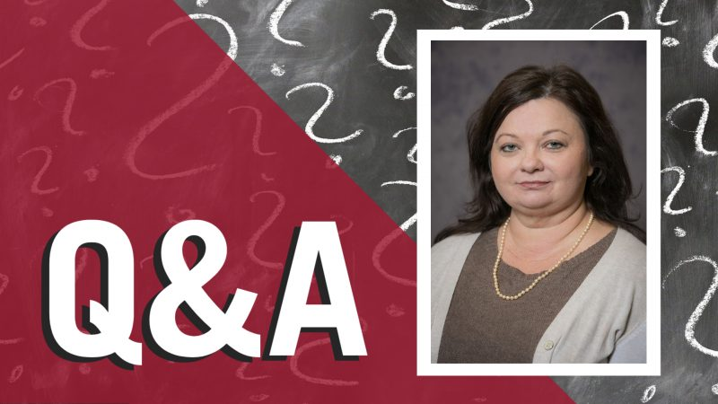The letters Q&A and portrait of Delphine Harris over a chalkboard with question marks drawn in chalk
